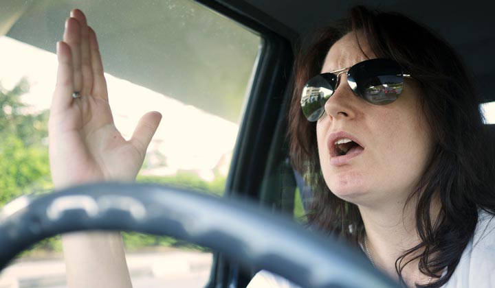 Photo of a woman getting angry while driving.